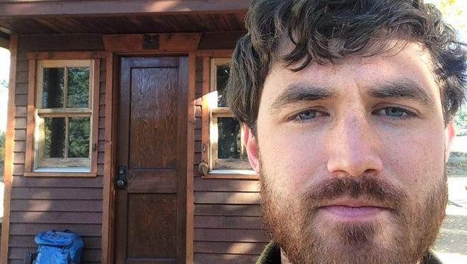Coralville native Jonathan Williams is shown with his 84-square-foot home in Colorado, which he hopes will keep him snug this winter.