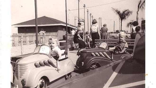The kiddie pedal cars in a 1960 photo.
