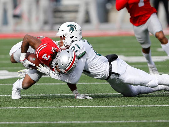 Ohio State cornerback Damon Arnette intercepts a pass intended for Michigan State's Cam Chambers.