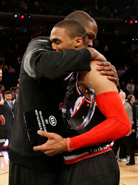 FILE - In this Feb. 15, 2015, file photo. Oklahoma City Thunder's Kevin Durant, left, and Russell Westbrook hug after Westbrook was given the MVP trophy after the NBA All-Star basketball game in New York. Oklahoma City's Russell Westbrook and Golden State's Kevin Durant were teammates for years, now are rivals, and are set to be teammates again for the Western Conference at the NBA All-Star Game in New Orleans this weekend. (AP Photo/Kathy Willens, File)
