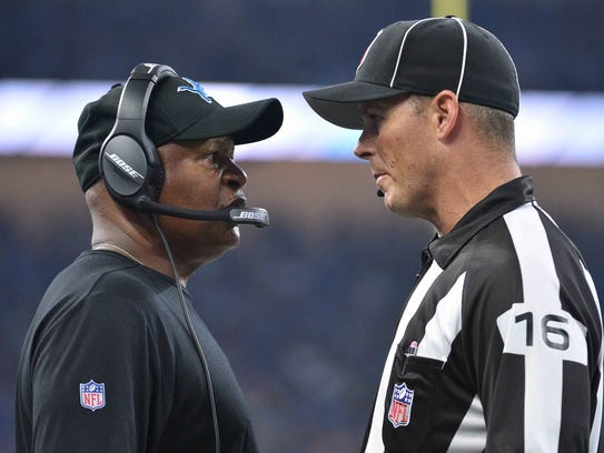 Lions coach Jim Caldwell talks to line judge Kevin Codey during the game against the Falcons at Ford Field on Sept. 24.