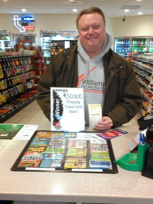Mark Williams at Lou's One Stop — the place where his $50,000 winning Powerball ticket was purchased. Williams plans to use the money to help the local community and to take a family vacation.