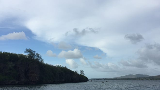 Partly sunny skies with some clouds in Agat