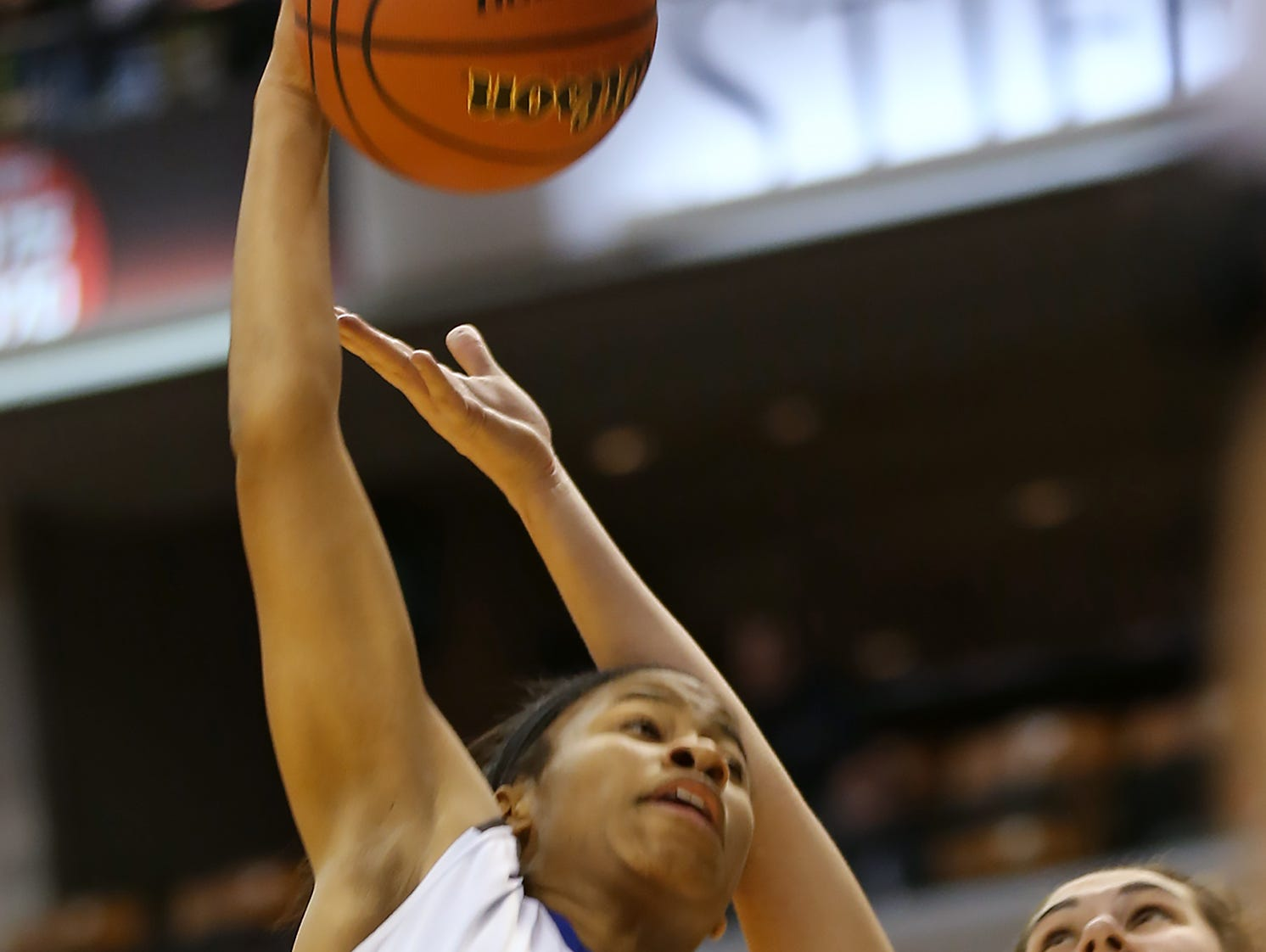 Heritage Christian's #52 Tyasha Harris rebounds over Ft. Wayne Canterbury's #23 Alexa Habig in first quarter action at the IHSAA Girls Class 2A girls basketball state finals game at Bankers Life Fieldhouse, Saturday, March 7, 2015. Heritage Christian won the game against Ft. Wayne Canterbury 73-53.