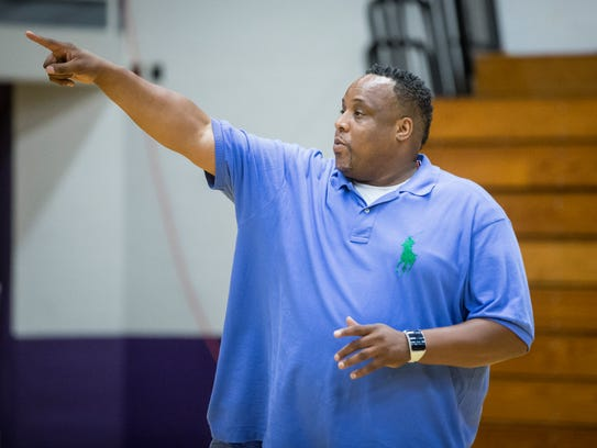 Chandler Thompson works with Central's basketball team