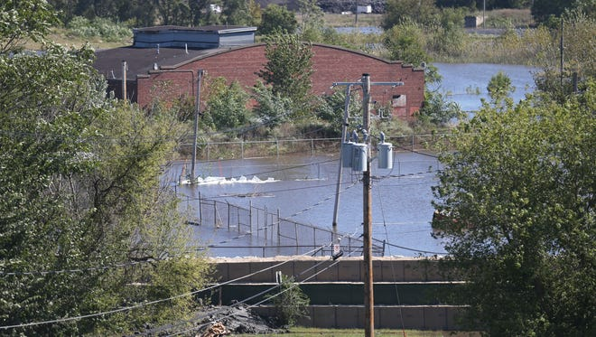 A wall of HESCO barriers, as seen from the roof of The National Building, protects the New Bohemian neighborhood from flooding on Tuesday, Sept. 27, 2016, in Cedar Rapids. The river reached its crest of 21.97 feet today and will not make it below flood stage for several more days.