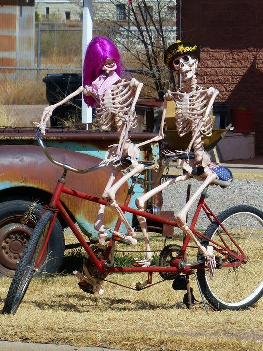 skeletons on bike