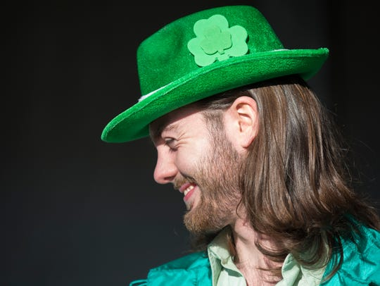 Chris Leising, 22, celebrates Green Beer Day at the