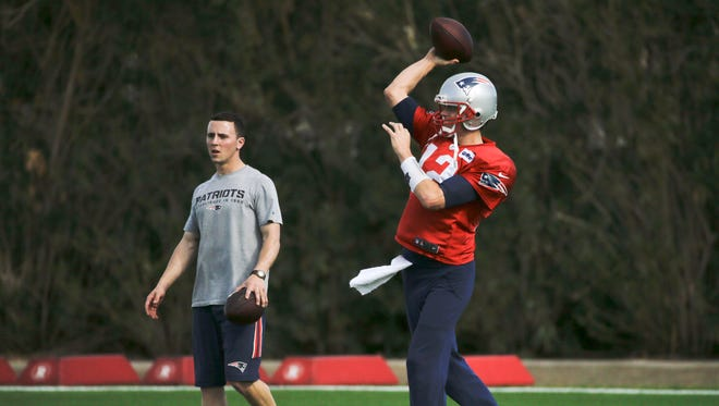 New England Patriots quarterback Tom Brady (12) passes during practice Wednesday, Jan. 28, 2015, in Tempe, Ariz. The Patriots play the Seattle Seahawks in NFL football Super Bowl XLIX Sunday, Feb. 1, in Glendale, Ariz.
