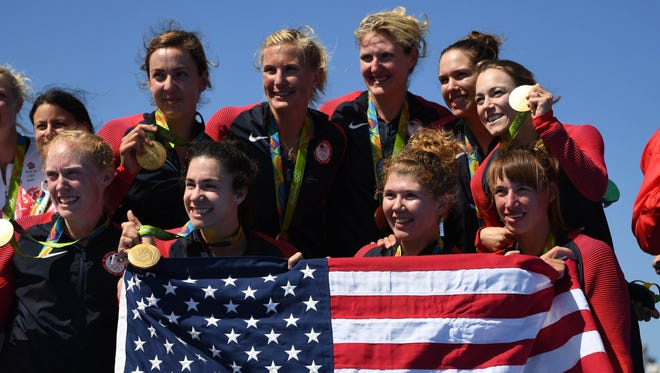 Team USA celebrates winning gold medals after the women's eight rowing competition in the Rio 2016 Summer Olympic Games at Lagoa Stadium on Aug 13.