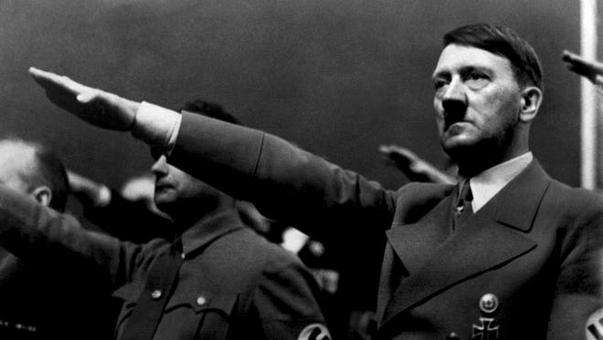 """A picture dated 1939 shows German Nazi Chancellor Adolf Hitler giving the nazi salute during a rally next to """"Deputy Furhrer"""" Rudolf Hess."""