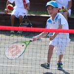 Hunter Peiser is a picture of concentration while playing a Red Ball tennis match against pros Aaron Krickstein and Jimmy Arias at the Bloomfield Open Hunt Club.
