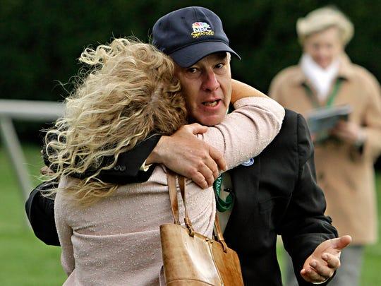 Trainer Charlie LoPresti gets a hug from Leona Velazquez, wife of jockey John Velazquez, after Wise Dan wins Saturday at Keeneland.