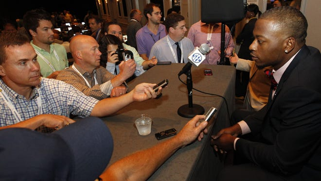 Mississippi defensive end CJ Johnson speaks to the media at the Southeastern Conference NCAA college football media days, Thursday, July 17, 2014, in Hoover, Ala. (AP Photo/Butch Dill)
