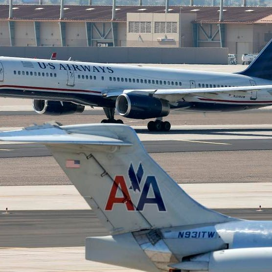 The Justice Department and a number of state attorneys general Tuesday challenged a proposed $11 billion merger between US Airways Group Inc. and American Airlines' parent company, AMR Corp.