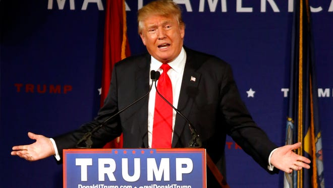 In this Dec. 7, 2015 file photo, Republican presidential candidate, businessman Donald Trump speaks  aboard the aircraft carrier USS Yorktown in Mt. Pleasant, S.C.