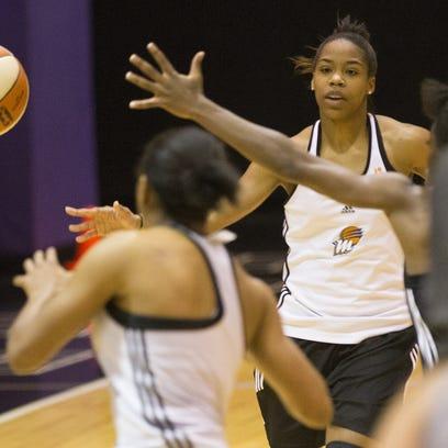 Phoenix Mercury guard Jasmine James passes the ball