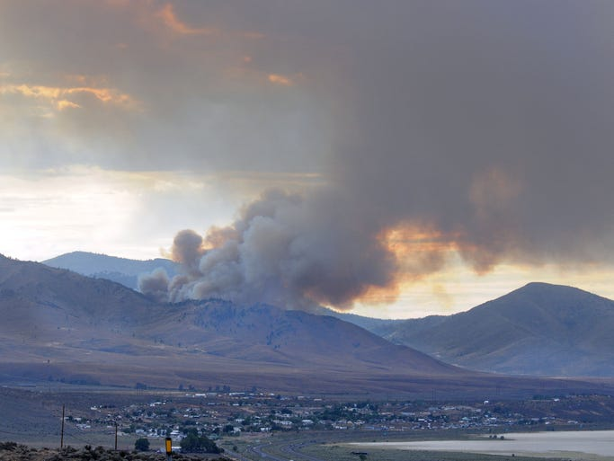The lightning-sparked Evans fire burns north of Bordertown on Tuesday July 15, 2014.