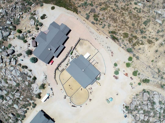 "Aerial view of the ranch property owned by Diane and Lee Helm in Glen Ilah. Yarnell Hill Fire officials called the ranch the ""Boulder Springs Ranch"" and designated it as an ""excellent safety zone"" for firefighters because of the metal roofs and lack of brush and trees surrounding the buildings."
