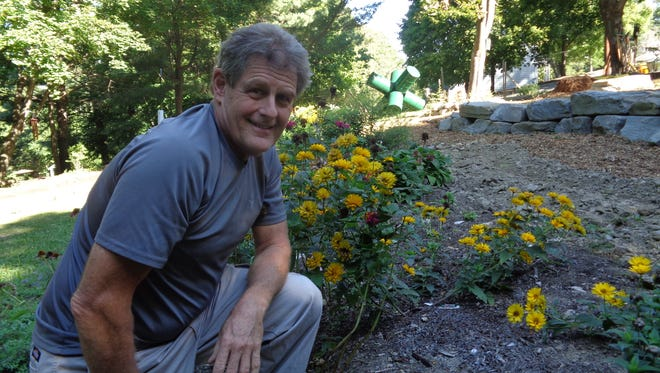 John Greene has spent thousands of hours transforming a blighted lot on Binghamton's South Side into a garden park.