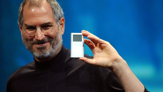 In this Jan. 6, 2004 file photo, Apple CEO Steve Jobs displayed the iPod mini at the Macworld Conference and Expo in San Francisco.