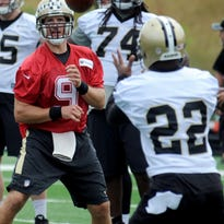 New Orleans Saints quarterback Drew Brees (9) passes the ball to running back Mark Ingram (22) during the NFL football team's training camp in White Sulphur Springs, W.Va., Friday, July 29, 2016. (AP Photo/Chris Tilley)