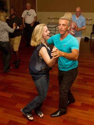 Erica Fernandez and her father Napoleon take part in salsa dance class at the Naples Performing Arts Center.