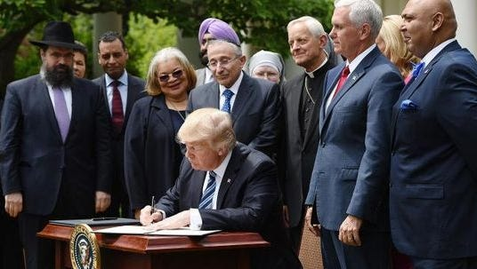 """President Trump signing executive order on """"religious freedom"""" in Rose Garden ceremony with religious leaders."""