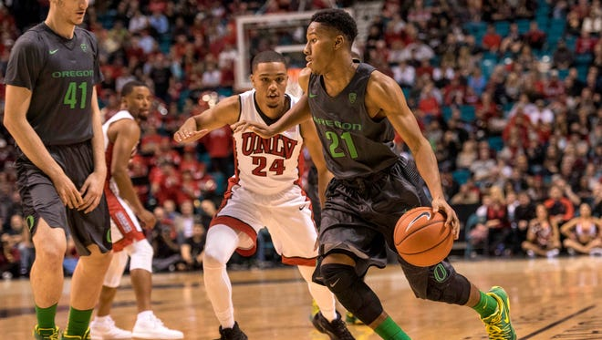 Dec 4, 2015; Las Vegas, NV, USA; Oregon Ducks guard Kendall Smalls (21) moves with the ball after getting past UNLV Rebels guard Jalen Poyser (24) during the second half at MGM Grand. UNLV won 80-69. Mandatory Credit: Joshua Dahl-USA TODAY Sports