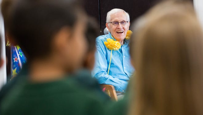 "J. Paul Taylor, smiles as students in the second grade at the J. Paul Taylor Academy, sing ""Las Mananitas"" during a celebration for his 97th birthday. Thursday Aug 24, 2017."