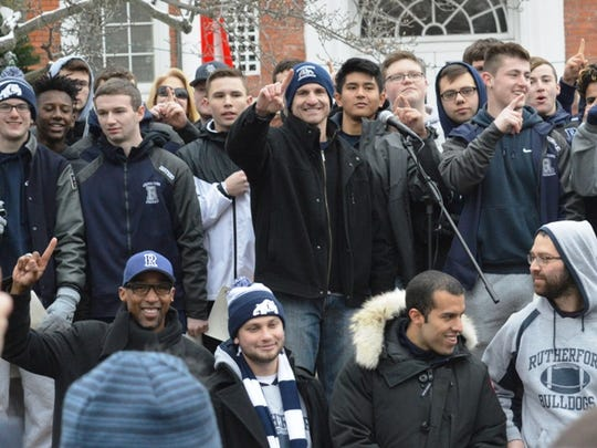 Rutherford High School football coach Andrew Howell (center) and his players showing who's No. 1 in front of Rutherford Borough Hall.