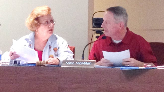 Silver Consolidated School Board President Frances Vasquez, left, visits with Vice President Michael McMillan prior to Tuesday's board meeting in Silver City.