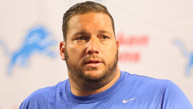 Detroit Lions center Dominic Raiola talks with reporters July 27, 2014, at the Allen Park training facility.