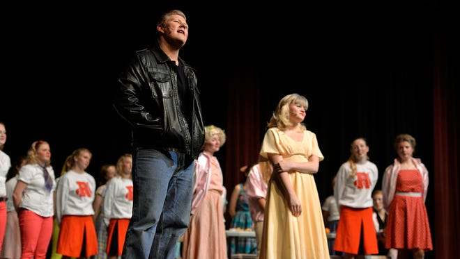 "Danny (Patrick Hoffmann) sings ""Summer Nights"" with Sandy (Lauren Davis) during a rehearsal of the Rocori High School production of ""Grease"" Monday at the school."