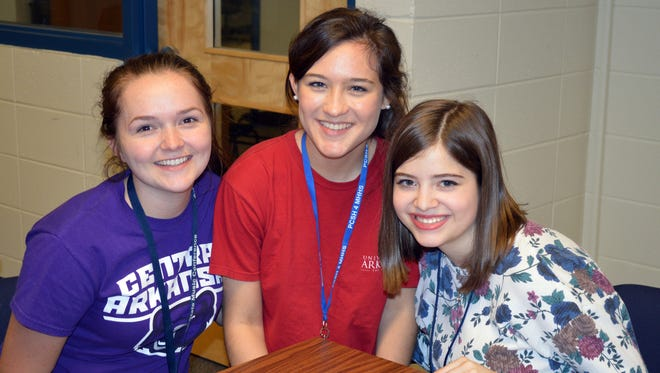 Seniors Jenni Matthews (from left), Michelle Morrow and Kate Vawter enjoy their last day of high school on May 10.
