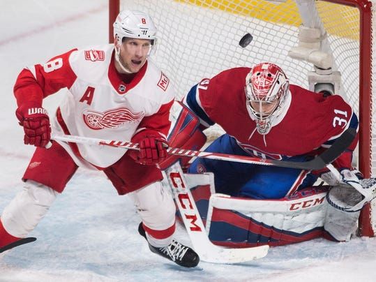 Detroit Red Wings left wing Justin Abdelkader (8) moves in against Montreal Canadiens goaltender Carey Price (31) during third-period NHL hockey game action in Montreal, Monday, March 26, 2018. (Graham Hughes/The Canadian Press via AP)