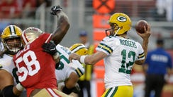 Green Bay Packers quarterback Aaron Rodgers, right,
