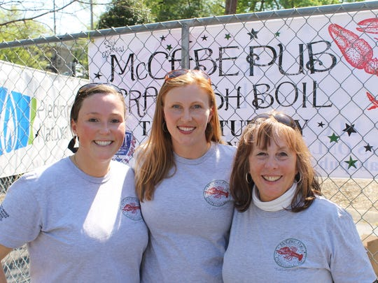 Stefanie Dean Brown, center, with her sister, Katie Dean, and her mother, Jo Dean, at the 2014 crawfish boil fundraiser for the LAM Foundation at McCabe Pub, which Katie Dean and Brown own