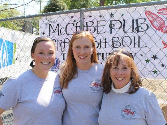 Stefanie Dean Brown, center, with her sister, Katie
