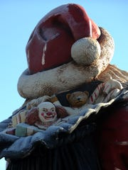 Presents in Santa's bag are some of the details few people get to see of The Community Bank statue.