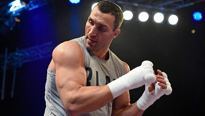 Wladimir Klitschko practices his form during a public workout at the Wembley Arena in London. Klitschko will fight Anthony Joshua on Saturday.