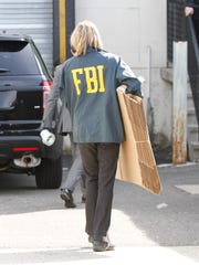 Federal agents execute a search warrant at the office