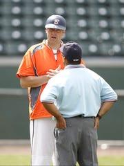 Briarcliff baseball coach John Schrader speaks to an umpire as Keio defeats Briarcliff 2-0 in the Class B sectional baseball game at Palisades Credit Union Park in Pomona on Saturday, May 28, 2016.