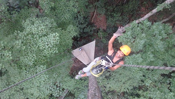Raela rappels for the first time from 75 feet up at The Gorge in Saluda, N.C.