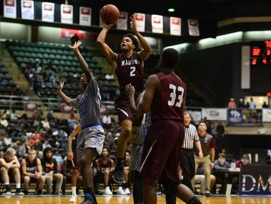 Nandua's Jaden Davis takes a jump shot against Carver Vo-Tech during the Governor's Challenge at the Wicomico Civic Center on Tuesday, Dec. 26, 2017.