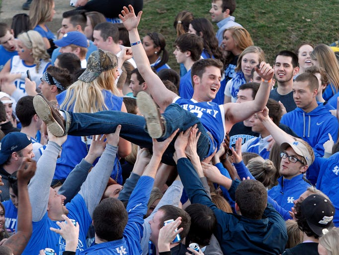 Kentucky fans celebrate a victory over Michigan on State St. near campus in Lexington. The victory sends Kentucky to the Final Four March 30, 2014