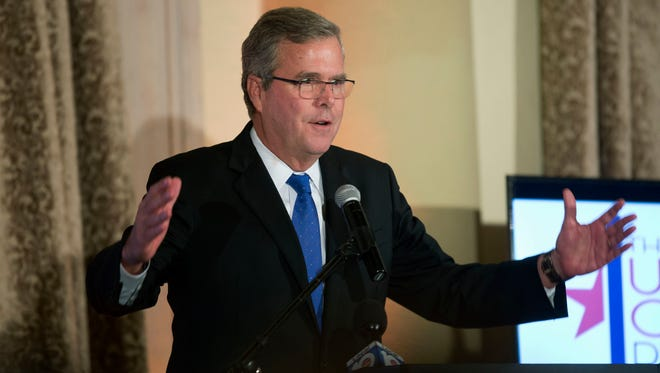 Former Florida governor Jeb Bush gestures while speaking to the U.S. Cuba Democracy PAC's 11th Annual Luncheon in Coral Gables, Fla., on Dec. 2, 2014.