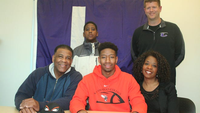 Lakeview standout Christopher Caleb-Lee Edwards has committed to play football at Kalamazoo College. He is joined by his parents Lonnie Edwards, Christrina Edwards, brother Jordan Edwards and Lakeview coach Matt Miller.