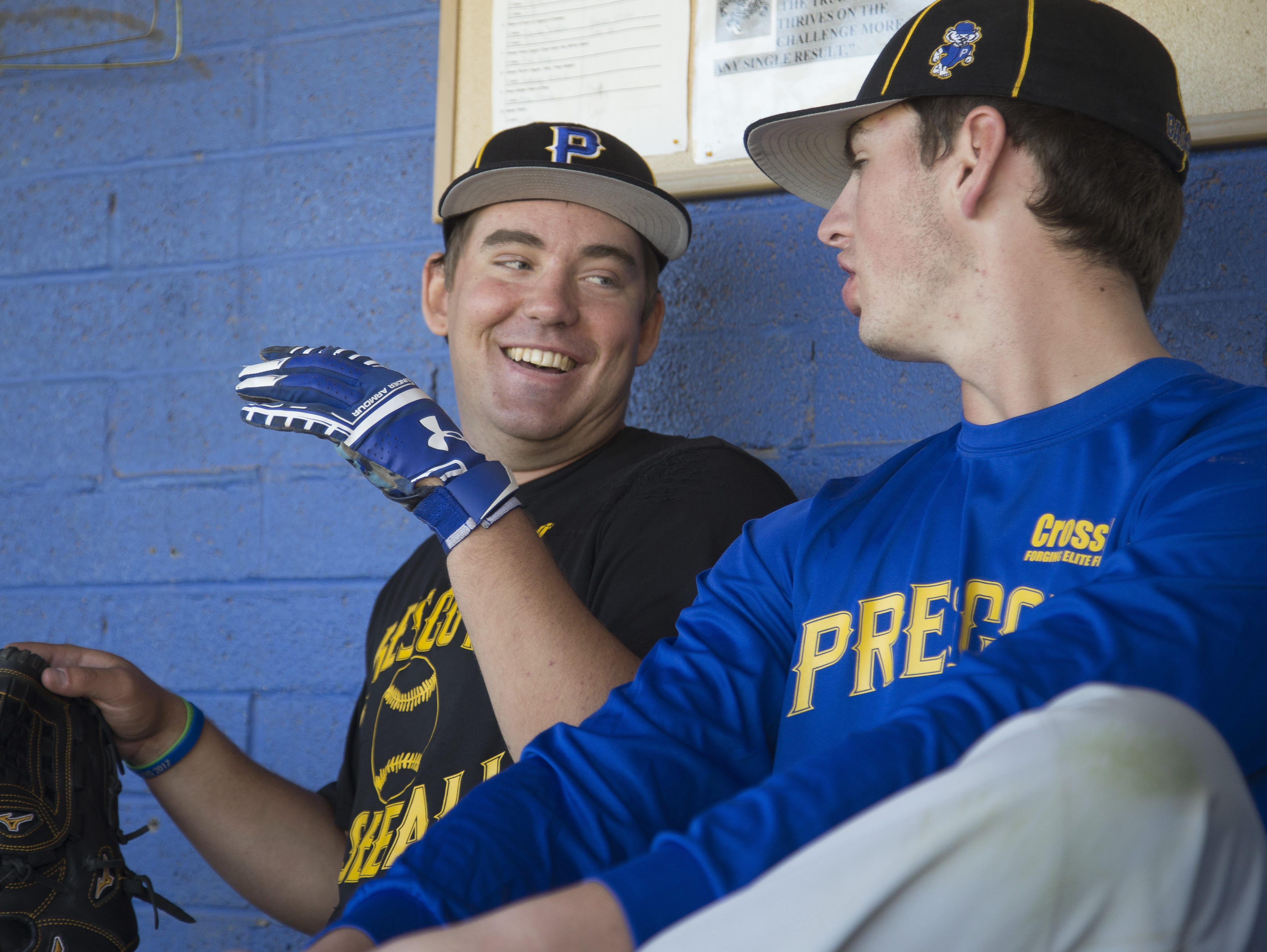 Prescott's Logan Carmick (in black) jokes with teammate Griffin Hays (R) before a baseball practice at Prescott High School on March 24, 2017 in Prescott, Ariz.