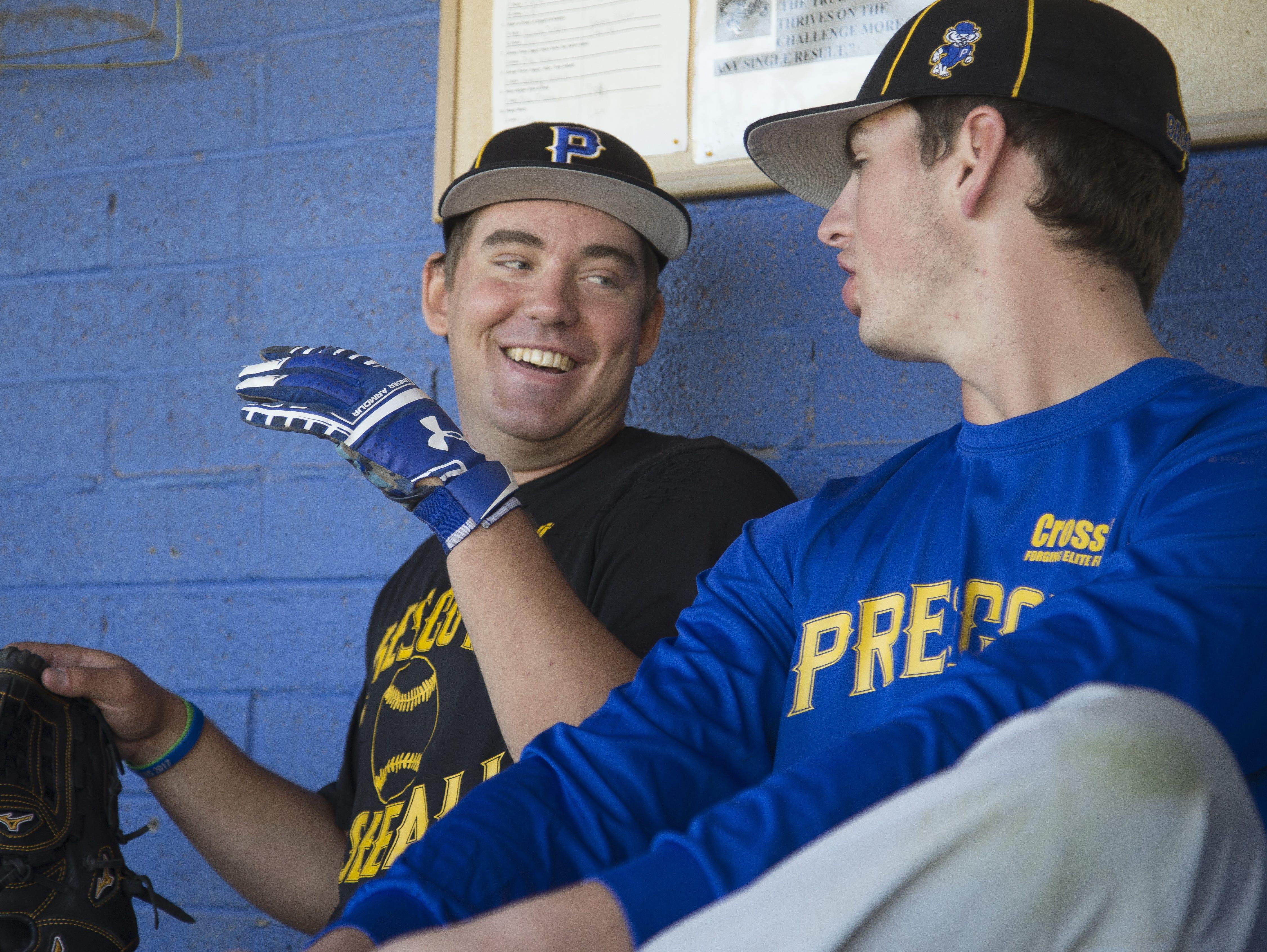 Prescott's Logan Carmick (in black) jokes with teammate Griffin Hays (R) before a baseball practice at Prescott High School on March 24, 2017 in Prescott, Ariz.